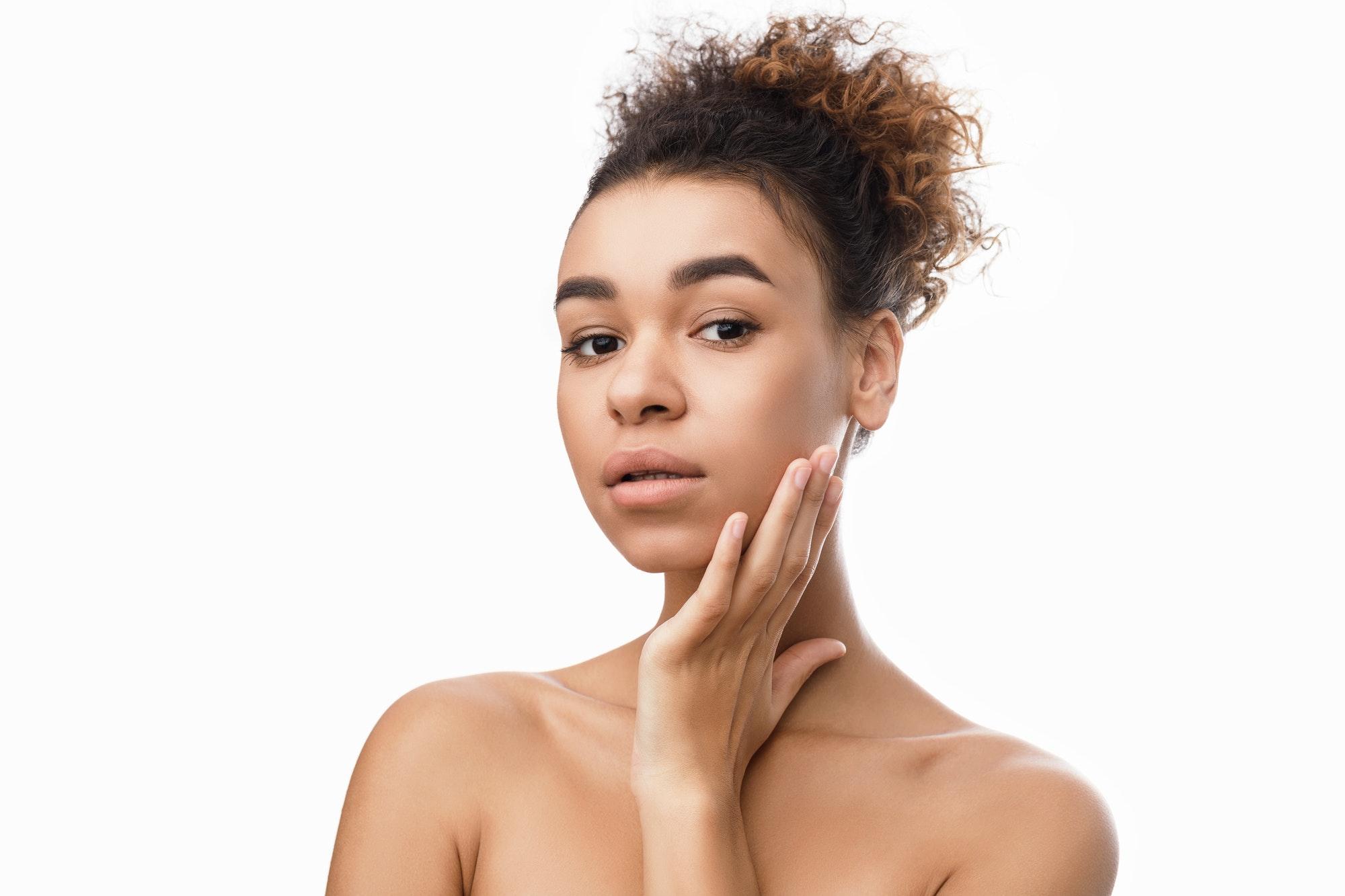 Facial treatment. Beautiful woman with clean fresh skin